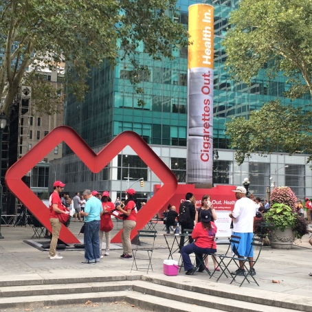 "To celebrate the end of tobacco sales, CVS filled Bryant Park with red hearts and a blow-up cigarette reading, ""Cigarettes Out. Health In."""